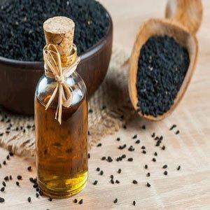 image graine et bouteille huile de nigelle